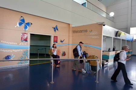cns: CAIRNS, AUS - APR 14 2016:Passengers arrive in Cairns Airport Queensland Australia. In the 12 months ending 30 June 2013 Cairns Airport had 4.1 million passengers, up 263,532 from the previous year.