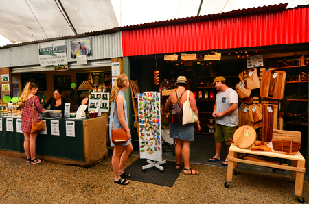 tableland: CAIRNS, AUS - APR 17 2016:Shoppers at the Heritage Markets a popular travel destination in Kuranda at the Atherton Tableland tropical north of Queensland, Australia Editorial