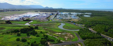 cns: CAIRNS, AUS - APR 23 2016:Aerial view of Cairns Airport in Queensland Australia. It is the seventh busiest airport in Australia. Editorial