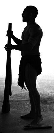 Yirrganydji Aboriginal man play Aboriginal music on didgeridoo, instrument during Aboriginal culture show in Queensland, Australia.(BW) Stock Photo - 57326838