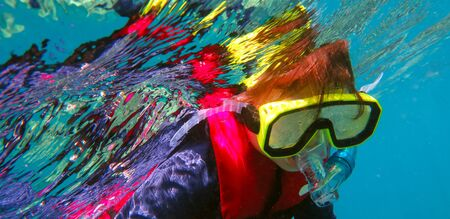 barrier: Little girl (age 5-6) snorkeling dive in the Great Barrier Reef Queensland Australia