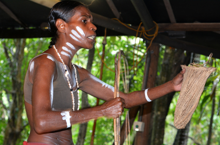 australian ethnicity: Yirrganydji Aboriginal woman explain about the home tools made by the indigenous Australian people of Queensland, Australia.