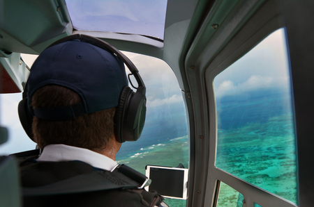great barrier reef marine park: Person fly in helicopter above the Great Barrier Reef Queensland Australia.