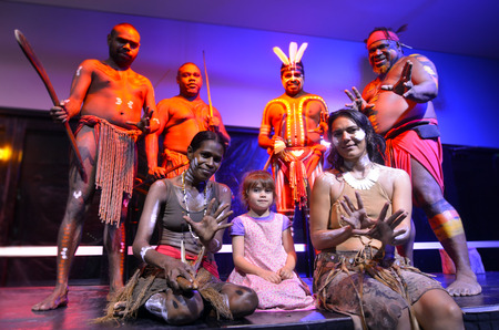 australian ethnicity: Little girl (age 05) photographed with Native Australian Yirrganydji Aboriginal people during cultural show in Queensland, Australia