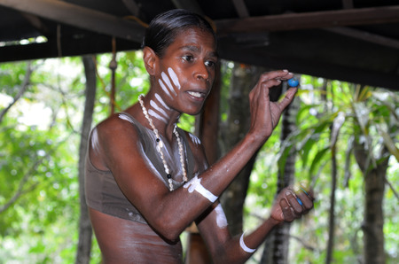 aborigines: Yirrganydji Aboriginal woman explain about the fruit and seeds food eaten by the indigenous Australian people from the rainforests of Queensland, Australia.