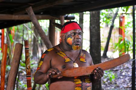 australian ethnicity: Yirrganydji Aboriginal warrior explain about Native Australian martial arts tools during cultural show in Queensland, Australia. Stock Photo