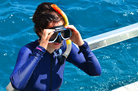 barrier reef: Woman prepare to  snorkeling dive in the Great Barrier Reef Queensland Australia