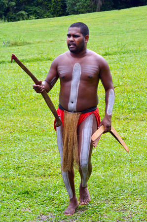 boomerangs: Yirrganydji Aboriginal warrior carry boomerangs during cultural show in Queensland, Australia. Stock Photo