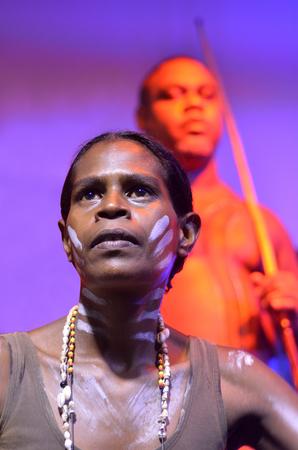 australian ethnicity: Yirrganydji Aboriginal woman and men during cultural show in Queensland, Australia.