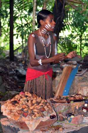 Yirrganydji Aboriginal woman explain about the fruit and seeds food eaten by the indigenous Australian people from the rainforests of Queensland, Australia.
