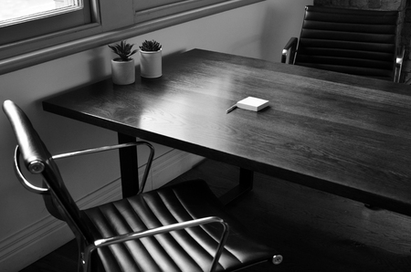 two chairs: Two chairs and a wooden office table. Office lifestyle concept