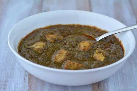 punjabi: Traditional Indian cuisine of Punjabi Palak Paneer food served in a plate. India food background and texture  copy space