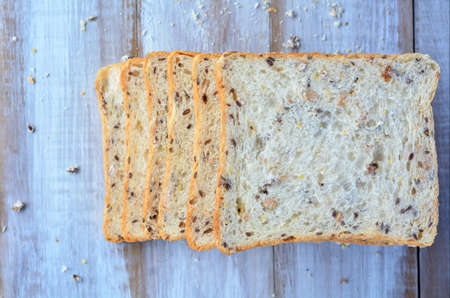 sliced bread: Flat lay of fresh sliced bread. Food background and texture with copy space