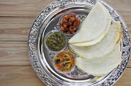 dosa: Flat lay of Indian food, Masala Dosa with Sambar and Channa Masala. Food background and texture. copy space Stock Photo