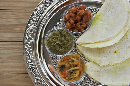 Flat lay of Indian food, Masala Dosa with Sambar and Channa Masala. Food background and texture. copy space Stock Photo