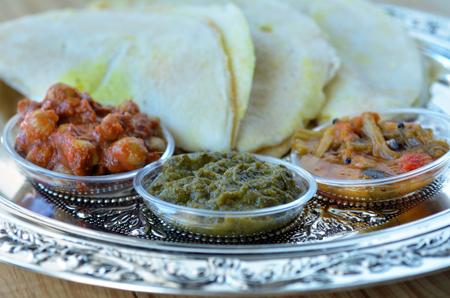 dosa: Above view of Indian food, Masala Dosa with Sambar and Channa Masala. Food background and texture.