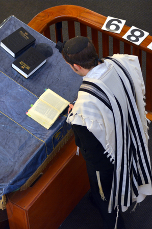 siddur: Auckland, New Zealand - July 06, 2016:Jewish rabbi read Torah.One of the Jewish man duty by the Jewish Law is it to pray three times daily: in the morning, in the afternoon and at nightfall.