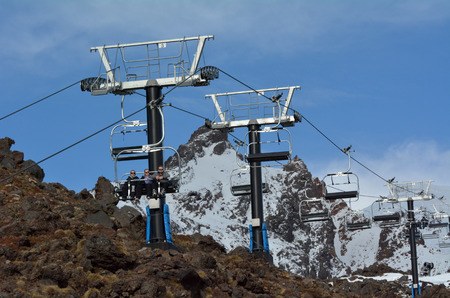 north island: NATIONAL PARK, NZL - JULY 12 2016:People travel on the Ski lift of Mount Ruapehu in Tongariro National Park in the centre of New Zealands North Island