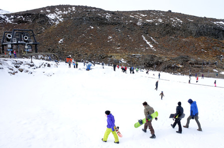 north island: NATIONAL PARK, NZL - JULY 12 2016:Snow skiers in Turoa skifield on Mount Ruapehu in Tongariro National Park in the centre of New Zealands North Island Editorial
