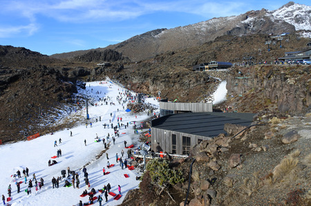 north island: NATIONAL PARK, NZL - JULY 12 2016:Snow skiers in Whakapapa skifield on Mount Ruapehu in Tongariro National Park in the centre of New Zealands North Island Editorial