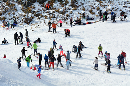 north island: NATIONAL PARK, NZL - JULY 12 2016:Visitors in Whakapapa skifield on Mount Ruapehu in Tongariro National Park in the centre of New Zealands North Island
