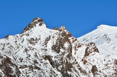 tongariro national park: Snow cap on Mount Ruapehu summit with blue sky. It is the highest mountain in the North Island of New Zealand (2020m above sea level) located in Tongariro National Park.