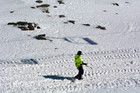 conducting: Unrecognizable avalanche control personal conducting risk assessment of potential avalanche on Mount Ruapehu the highest mountain in the North Island of New Zealand located in Tongariro National Park. Stock Photo