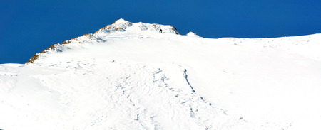 tongariro national park: Unrecognizable avalanche control personal conducting risk assessment of potential avalanche on Mount Ruapehu the highest mountain in the North Island of New Zealand located in Tongariro National Park. Stock Photo