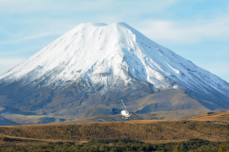 Helicopter fly around Mount Ngauruhoe in Tongariro National Park.The mountain was used as a stand-in for the fictional Mount Doom in Peter Jacksons The Lord of the Rings film trilogy.