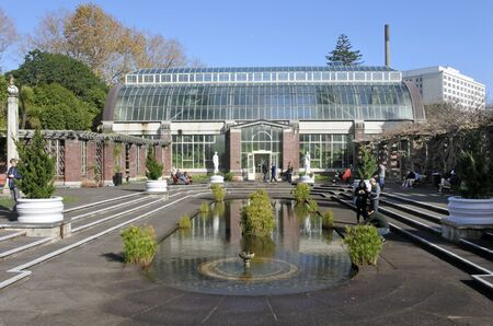 Hot house: AUCKLAND - JULY 24 2016:People visit in Auckland Wintergardens.View of the tropical hot house of the Wintergardens from the temperate house.
