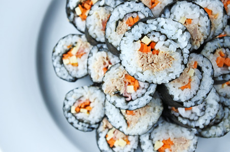 roll bar: Top view of stack of sushi maki gunkan roll plate or platter set . Served in Japanese bar restaurant with chopstick. Flat lay. Food background. copy space Stock Photo