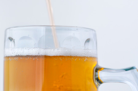personal point of view: Personal point of view of a person pouring beer into a mug. Food and drinks background.Alcohol consumption concept. copy space