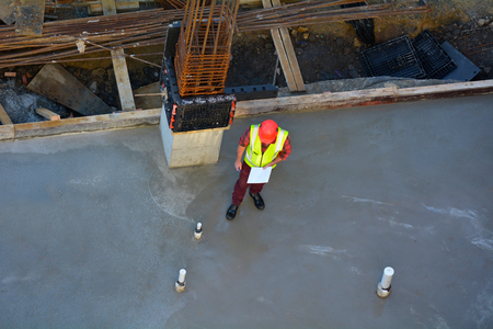 manual test equipment: Aerial view of a foreman builder inspecting concrete construction. Copy space Editorial
