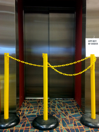 inconvenience: An out of order elevator lift with notice sign.