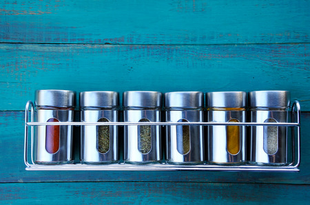 Spice rack on a wooden wall. Food background. copy space