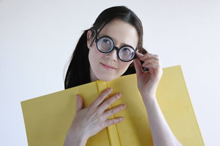 geeky: Geeky woman inspired from a story she read in a book. Women education concept. real people copy space Stock Photo