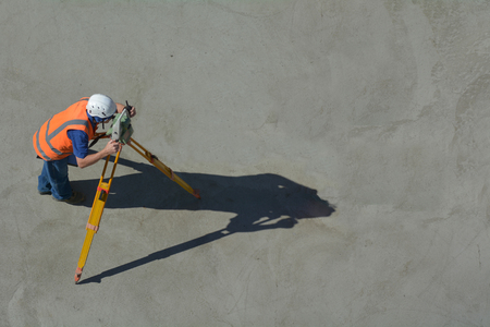 land surveying: Aerial view of unrecognizable land surveying in construction site. copy space