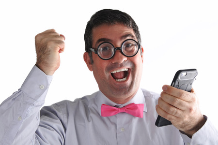 geeky: Happy Geeky man receives  an exciting message or phone call. Communication concept. Real people copy space