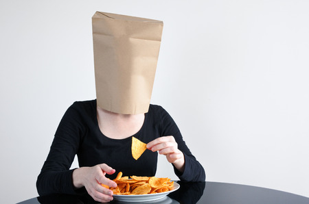 blindly: Anonymous woman blindly eats unhealthy food. Woman healthcare concept. copy space Stock Photo