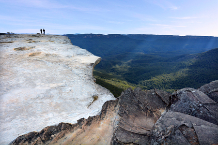 unrecognisable people: Unrecognisable people hikes on Lincoln Rock Lookout at sunset in the Blue Mountains National Park in the Blue Mountains region of New South Wales, Australia