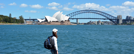 new south wales: Woman looks at Sydney skyline New South Wales, Australia.