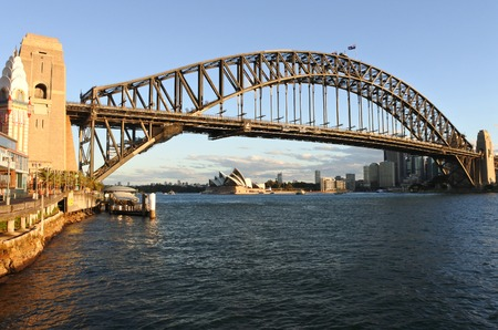 sydney harbour bridge: Sydney Harbour Bridge west side and Sydney Skyline during sunset in New South Wales Sydney, Australia Stock Photo