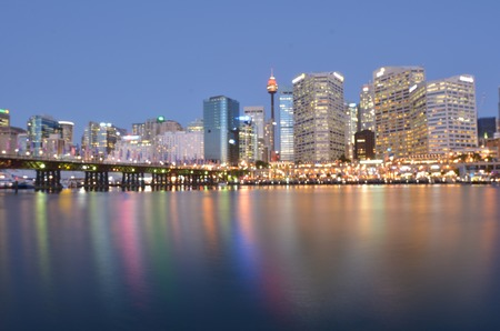 Blurry background of Darling Harbour at dusk, a recreational and pedestrian precinct situated on western outskirts of the Sydney central business district in New South Wales, Australia.
