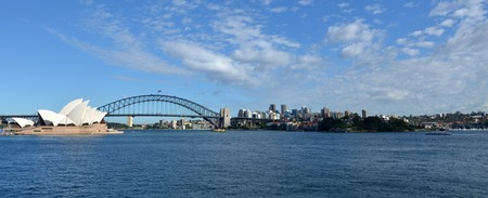 new south wales: Panoramic view of Sydney Harbour skyline with the Sydney Harbour Bridge and the Opera House in New South Wales, Australia.