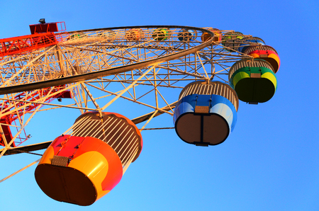 Low angle point of view of a colorful Ferris wheel in Sydney  New South Wales, Australia