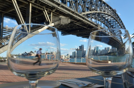 sydney harbour bridge: Sydney Harbour Bridge west side and Sydney Skyline from a restaurant table point of view in New South Wales Sydney, Australia
