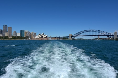 Panoramic view of Sydney skyline from a ferry in New South Wales, Australia.