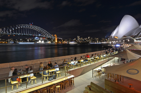 Sydney Harbour Bridge and the Opera House skyline at night as view from Sydney cove in Sydney New South Wales, Australia.