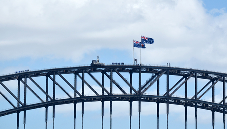 The Australian National flag (R) and the state flag of New South Wales (L) flies above Sydney Harbour Bridge in Sydney, Australia
