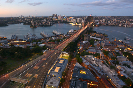 sydney harbour bridge: Aerial view at dusk of Sydney Harbour Bridge towards North Sydney, New South Wales Australia. Stock Photo